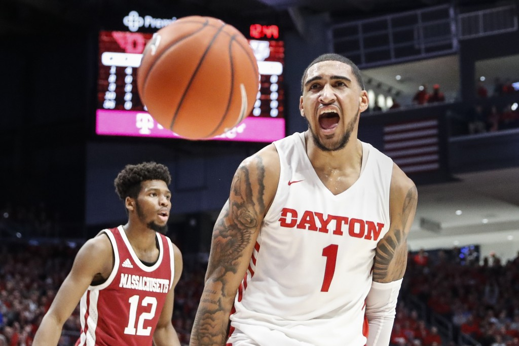 Dayton's Obi Toppin (1) reacts after dunking during the first half of an NCAA college basketball game against Massachusetts, Saturday, Jan. 11, 2020, ...