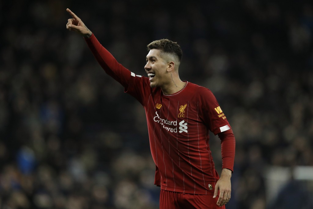Liverpool's Roberto Firmino celebrates at the end of the English Premier League soccer match between Tottenham Hotspur and Liverpool at the Tottenham ...