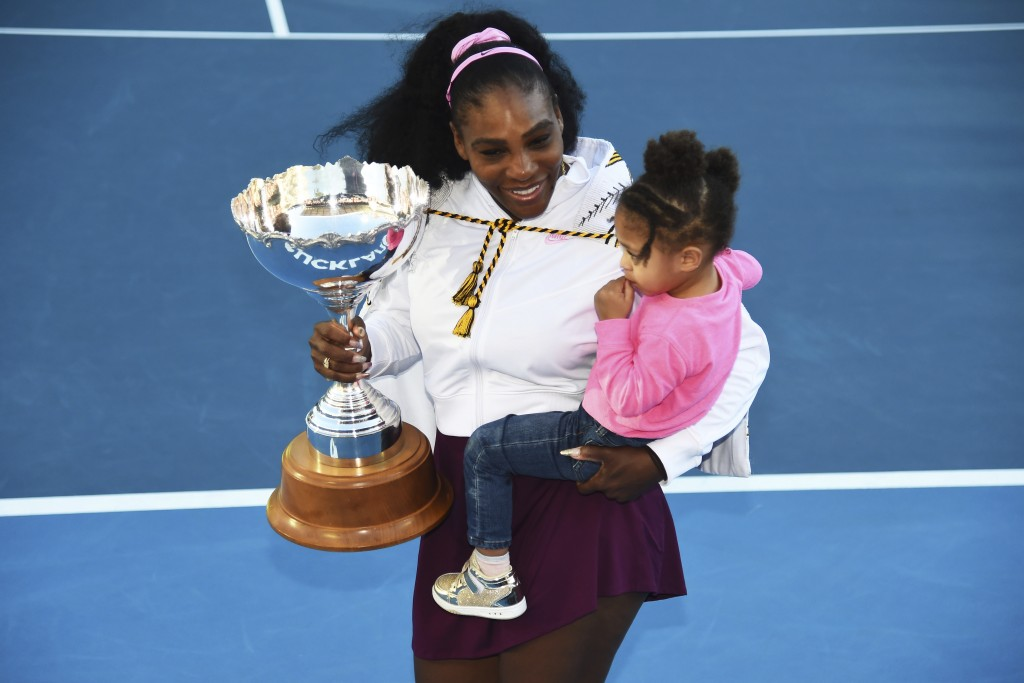 Serena Williams from the United States with daughter Alexis Olympia Ohanian Jr. and the ASB trophy after winning her singles finals match against Unit...