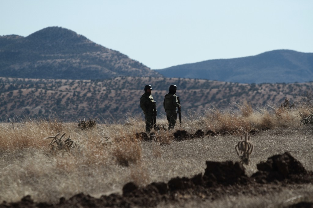 National Guard soldiers stand guard near Bavispe, Sonora state, Mexico, where family members of the extended LeBaron family were ambushed by gunmen la...