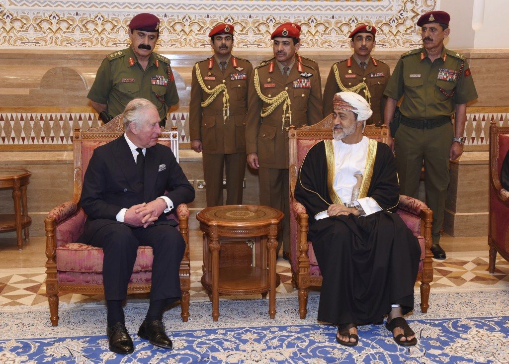 In this photo made available by Oman News Agency, Oman's new Sultan Haitham bin Tariq Al Said, right, receives The Prince of Wales after his arrival t...