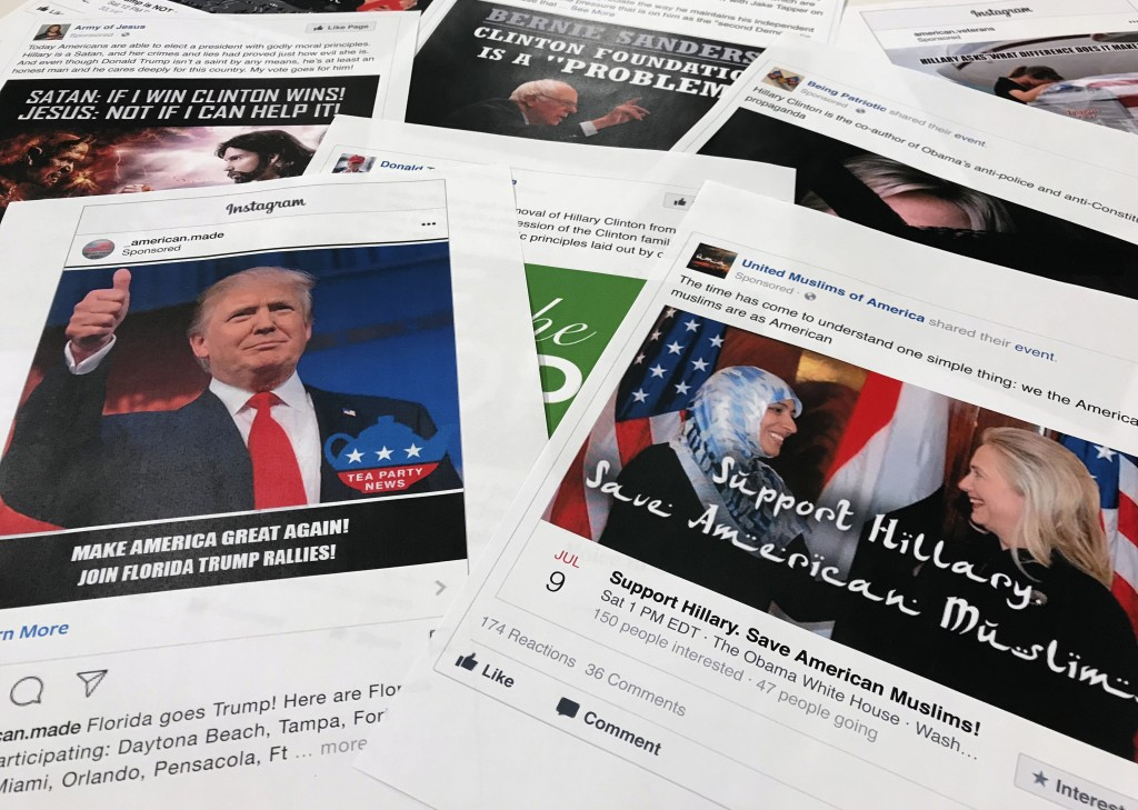 FILE - This Nov. 1, 2017 file photo shows printouts of some of the Facebook and Instagram ads linked to a Russian effort to disrupt the American polit...