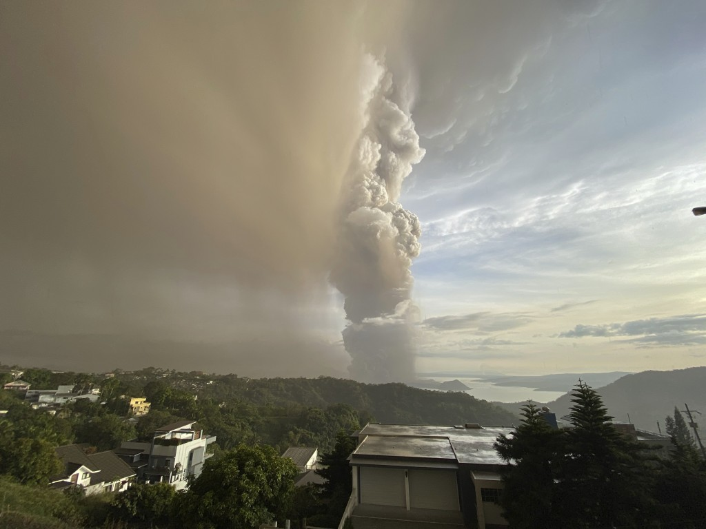 In this Jan. 12, 2020, photo, plumes of smoke and ash rise from as Taal Volcano erupts in Tagaytay, Cavite province, outside Manila, Philippines (AP P...
