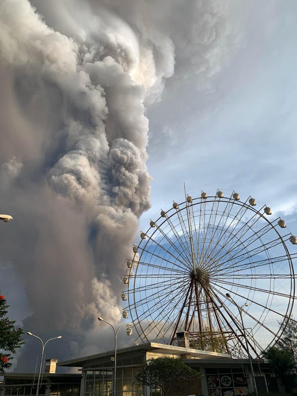 In this Jan. 12, 2020, photo, Taal volcano releases ash and smoke during an eruption in Tagaytay, Cavite province south of Manila, Philippines. (AP Ph...
