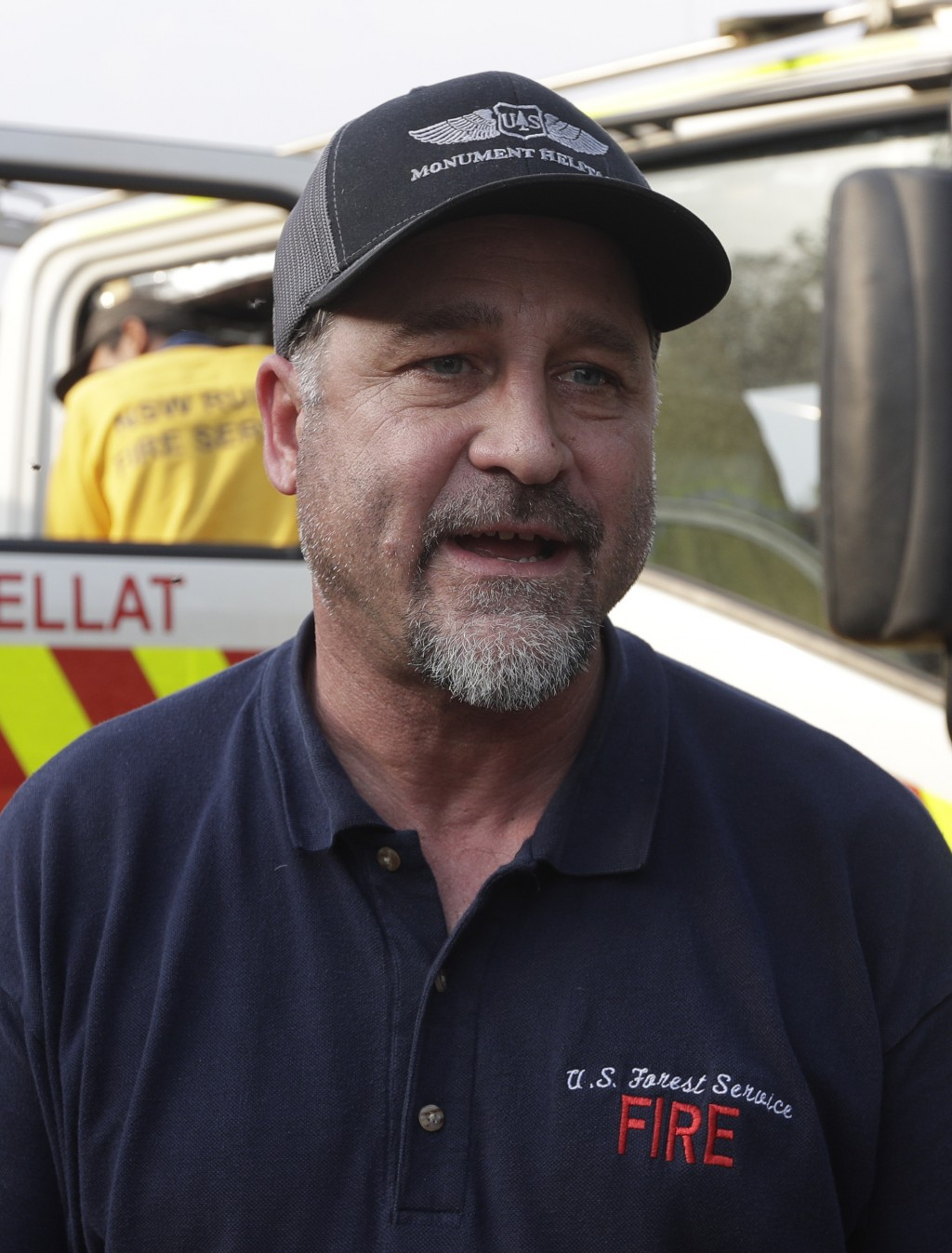 In this Jan. 10, 2020, photo, American firefighter Bill King arrives at a staging area at Candelo, Australia, before moving on to the fire brigade at ...