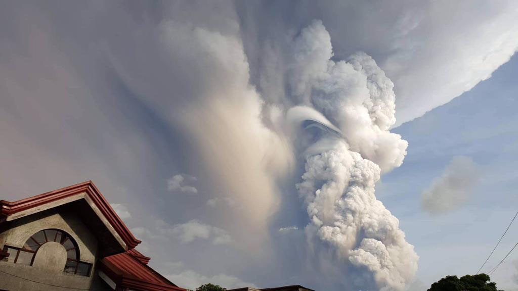 Taal Volcano spews ash and smoke during an eruption as seen from Cavite province, south of Manila, Philippines on Sunday. Jan. 12, 2020. (Jogs Danao/A...