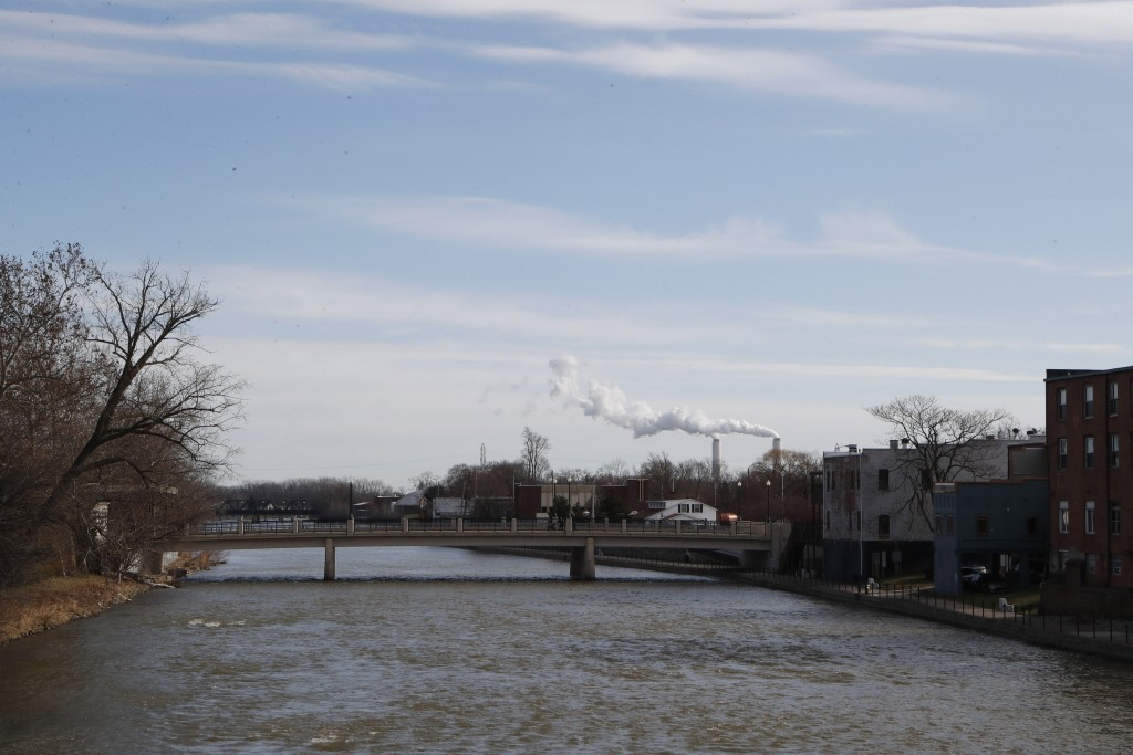 This Tuesday, Jan. 7, 2020 photo shows the River Raisin flowing east through Monroe, Mich. Monroe County, population 150,000, has suffered six militar...