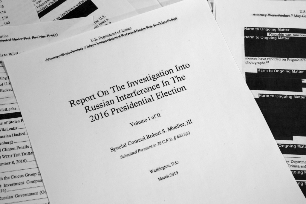 FILE - This Thursday, April 18, 2019 file photo shows special counsel Robert Mueller's redacted report on Russian interference in the 2016 presidentia...