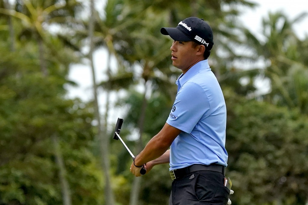 Collin Morikawa reacts to missing his birdie putt on the 10th green during the third round of the Sony Open PGA Tour golf event, Saturday, Jan. 11, 20...