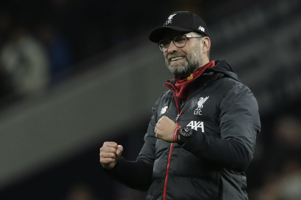 Liverpool's manager Jurgen Klopp celebrates at the end of the English Premier League soccer match between Tottenham Hotspur and Liverpool at the Totte...
