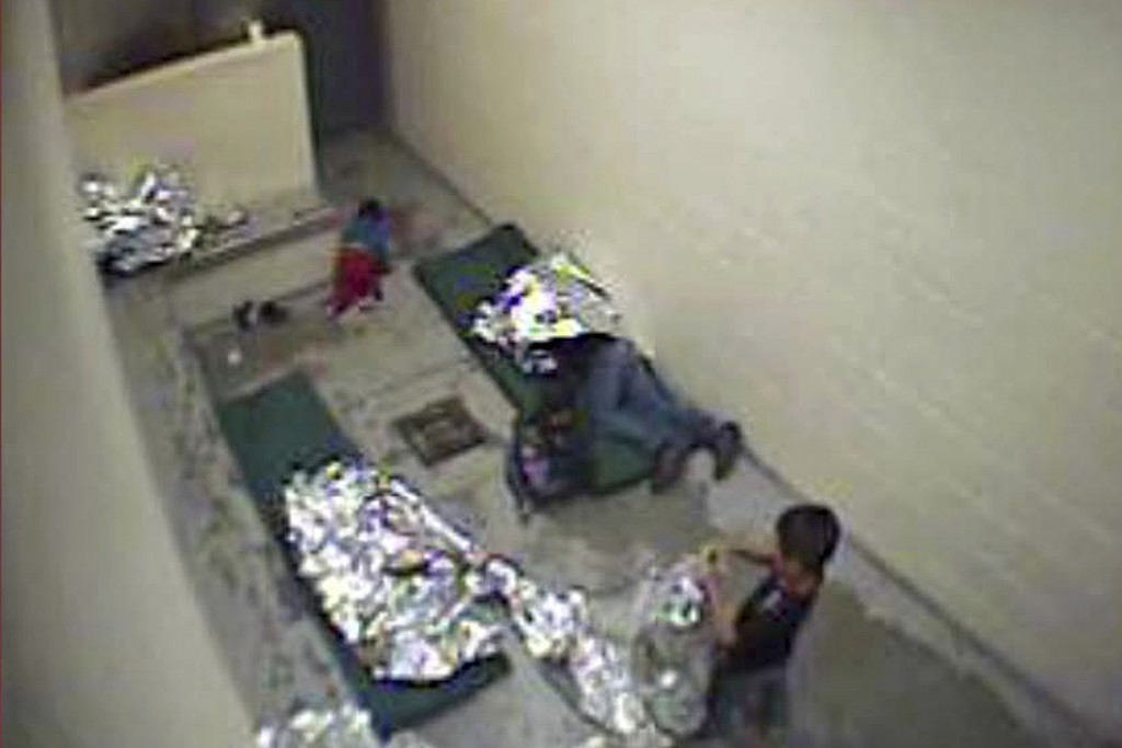 FILE - This Sept. 2015, file image made from U.S. Border Patrol surveillance video shows a child crawling on the concrete floor near the bathroom area...