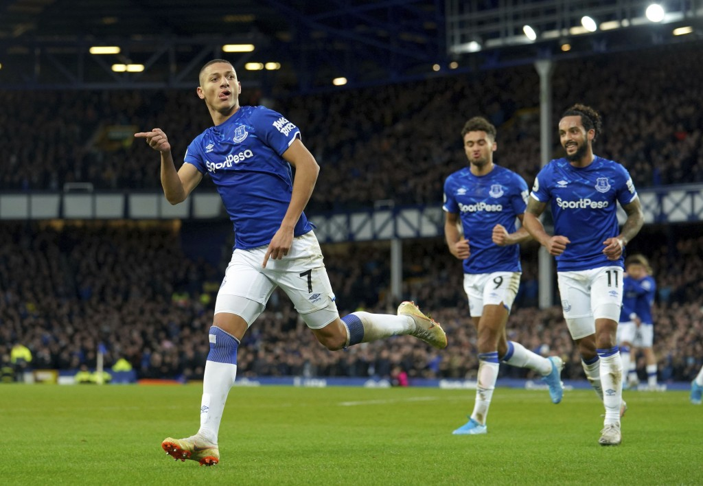 Everton's Richarlison scores his side's first goal of the game, during the English Premier League soccer match between Everton and Brighton at Goodiso...