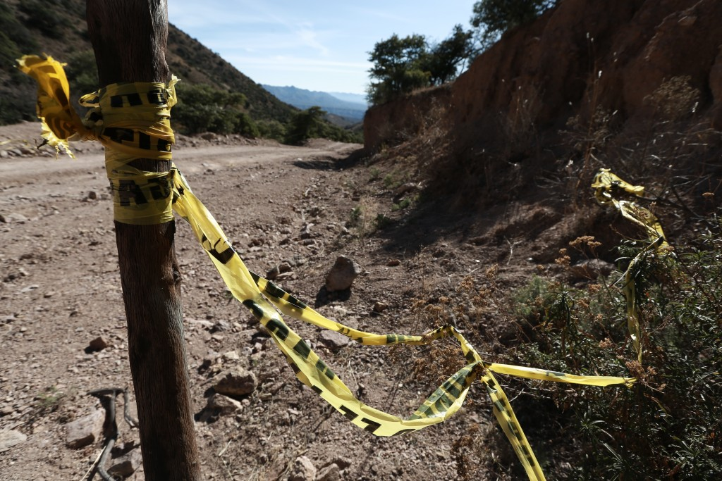 Police tape remains where one of the cars belonging to the extended LeBaron family was ambushed by gunmen last year near Bavispe, Sonora state, Mexico...