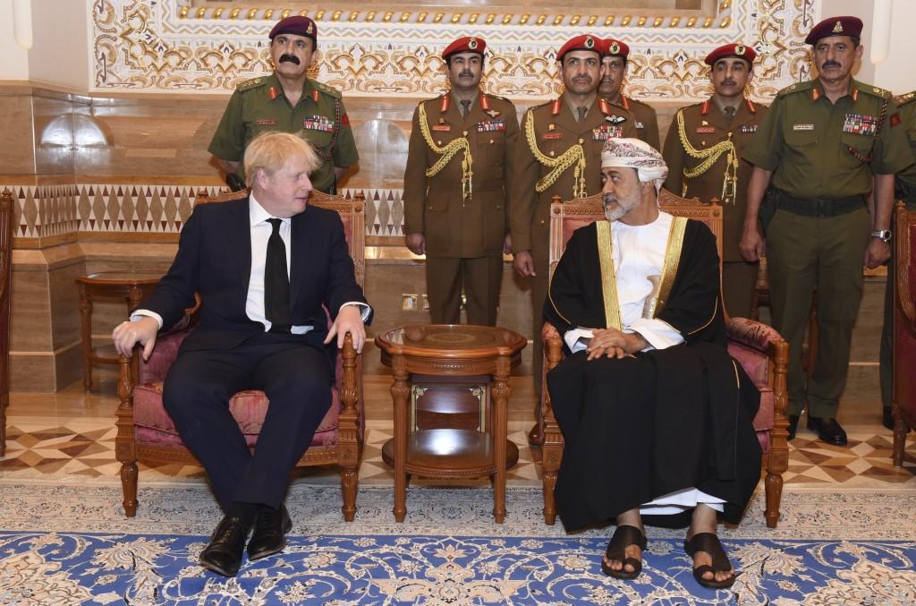 In this photo made available by Oman News Agency, Oman's new sultan Haitham bin Tariq Al Said, right, receives Britain's Prime Minister Boris Johnson ...