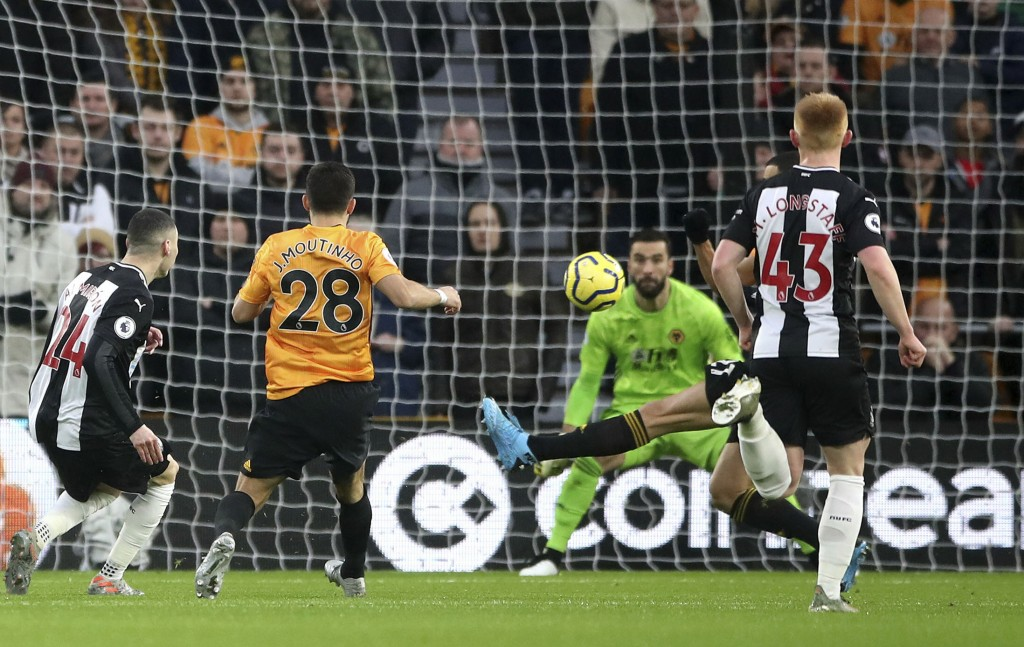 Newcastle United's Miguel Almiron scores during the English Premier League soccer match between Wolverhampton Wanderers and Newcastle United at Moline...