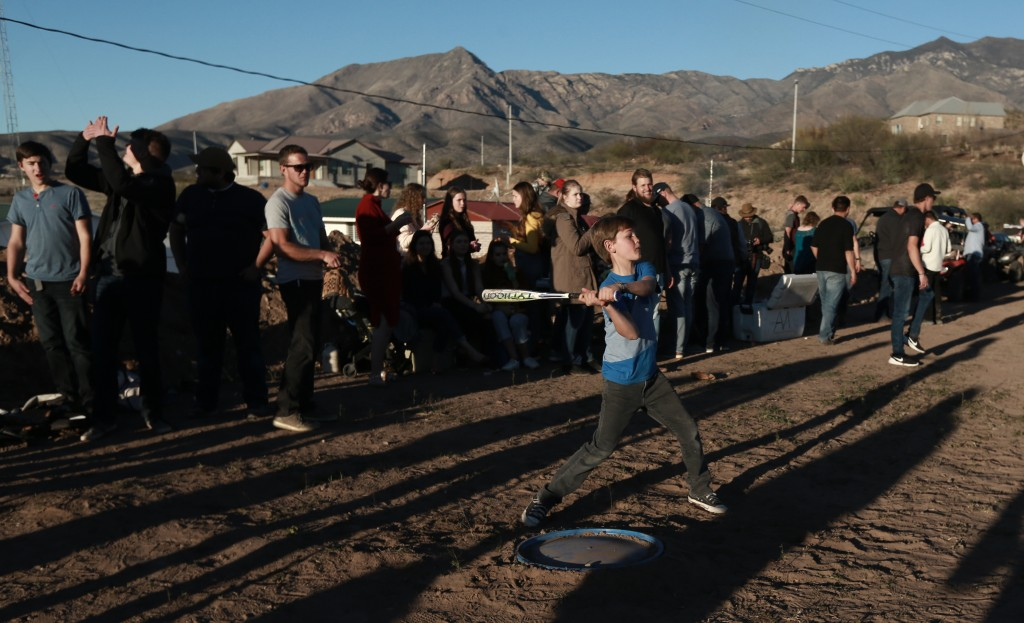 Boys play baseball in La Mora, Sonora state, Mexico, one day before the expected arrival of Mexican President Andrés Manuel López Obrador, Saturday, J...