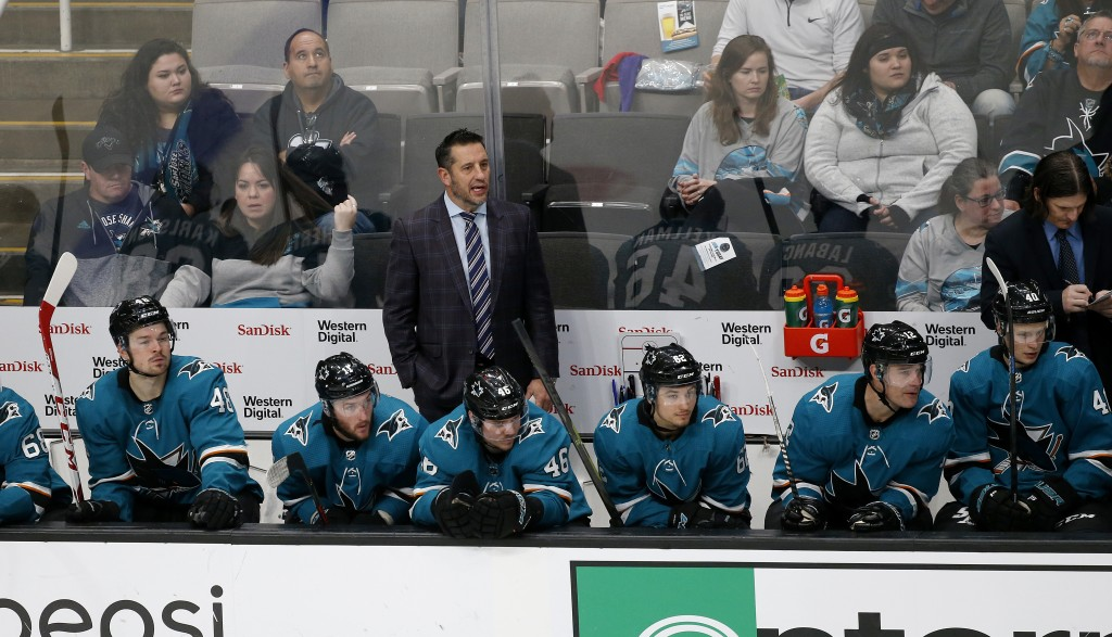 San Jose Sharks interim coach Bob Boughner, center, watches the team play the Dallas Stars during the third period of an NHL hockey game in San Jose, ...