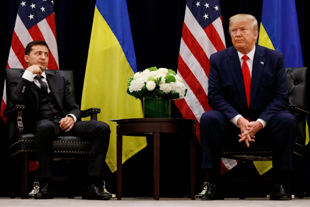 FILE - In this Sept. 25, 2019 file photo, President Donald Trump meets with Ukrainian President Volodymyr Zelenskiy in New York during the United Nati...