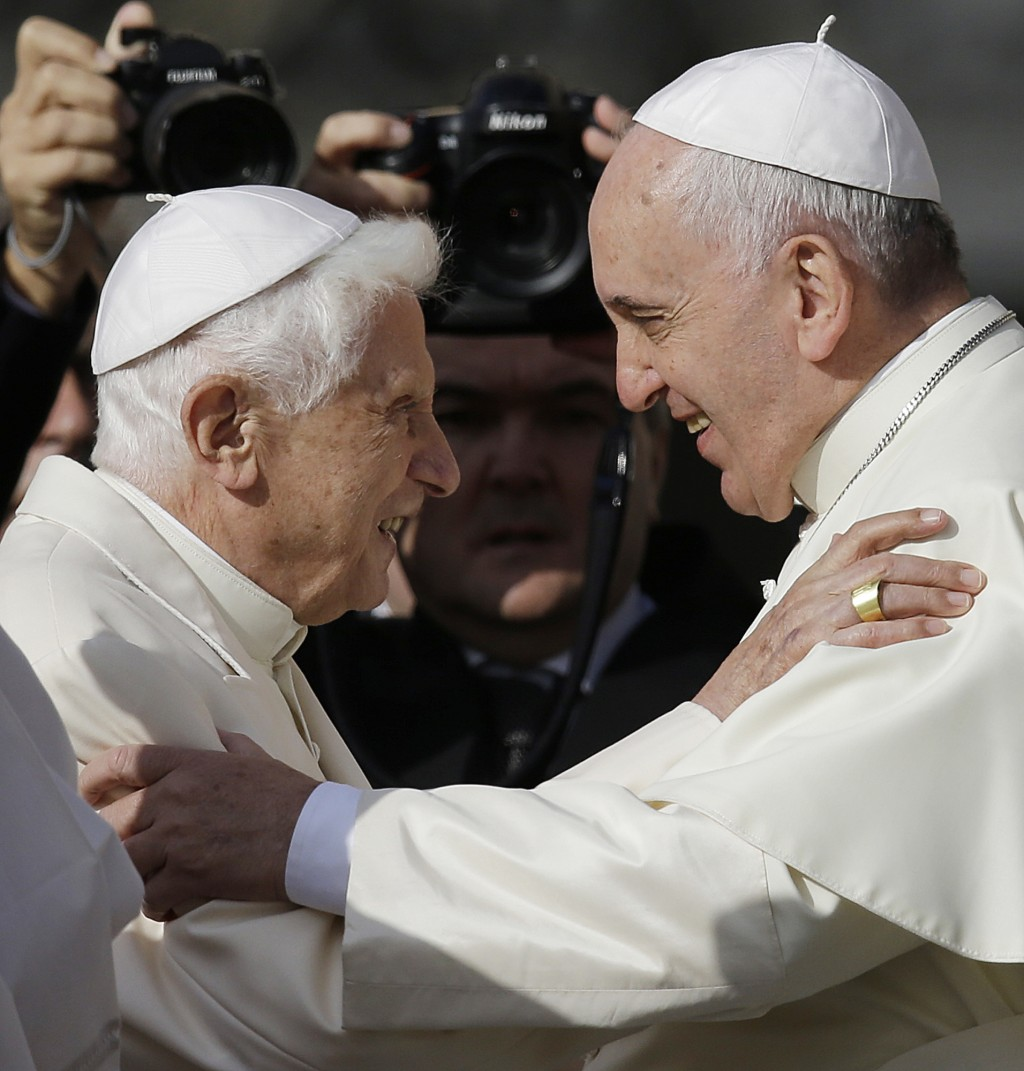 FILE - In this Sept. 28, 2014 file photo, Pope Francis, right, hugs Pope Benedict XVI prior to the start of a meeting with elderly faithful in St. Pet...