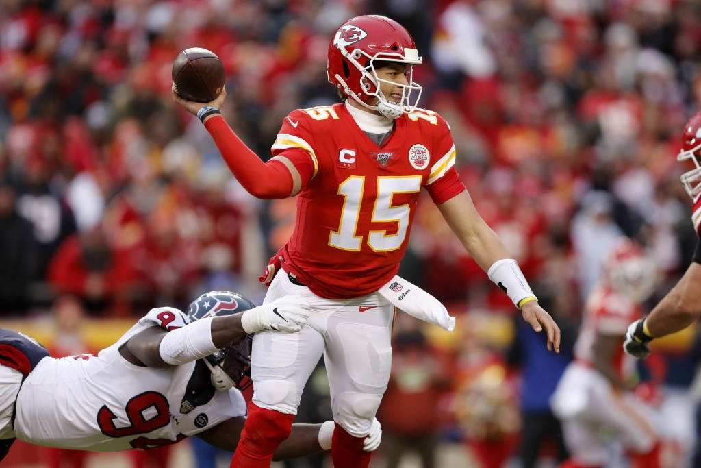 Kansas City Chiefs quarterback Patrick Mahomes (15) throws under pressure from Houston Texans defensive end Charles Omenihu (94) during the first half...
