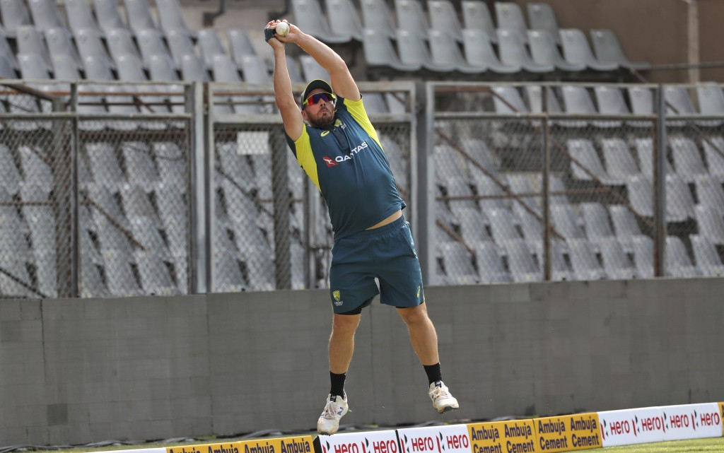 Australia's captain Aaron Finch attends a training session ahead of their first one-day international cricket match against India in Mumbai, India, Mo...