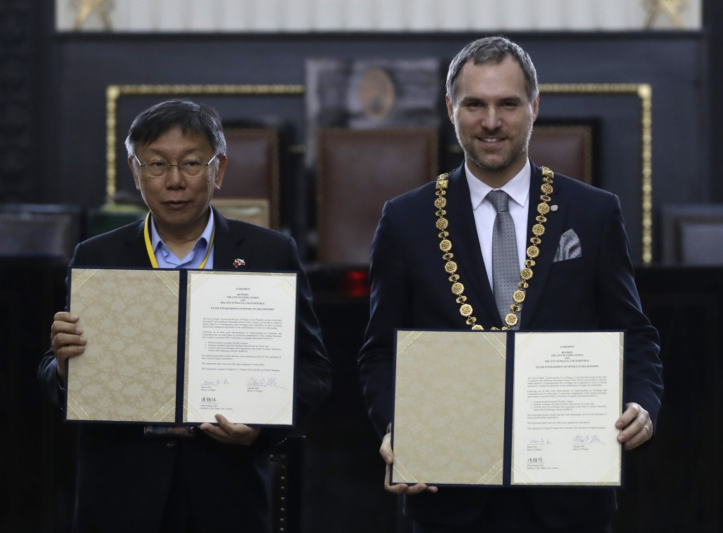 Mayor of Prague Zdenek Hrib, right, and Taipei city mayor Ko Wen-je display a partnership agreement between the two cities at at the Old Town City Hal...