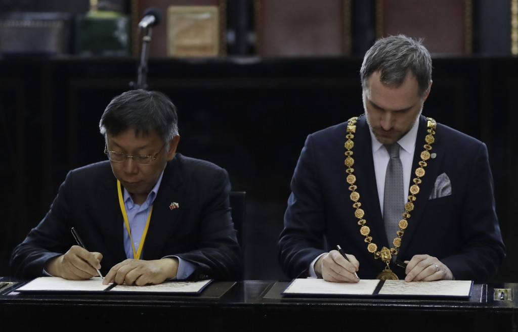 Mayor of Prague Zdenek Hrib, right, and Taipei city mayor Ko Wen-je sign a partnership agreement between the two cities at at the Old Town City Hall i...