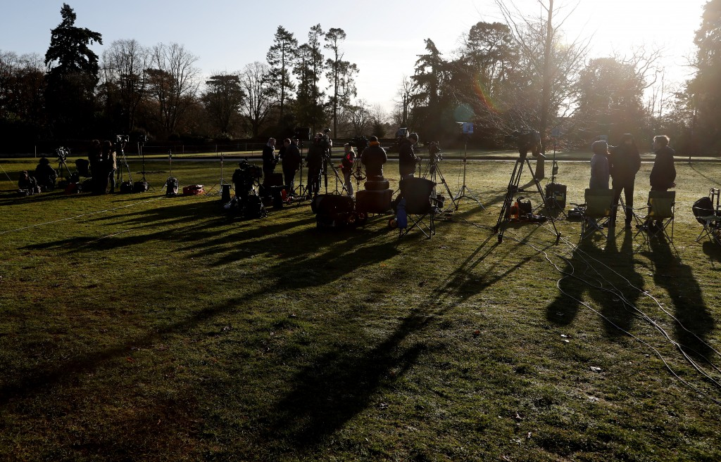 The media prepare at the entrance of Sandringham estate, Sandringham, England, early morning Monday, Jan. 13, 2020. Britain's Queen Elizabeth II  is p...