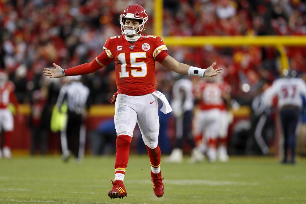 Kansas City Chiefs quarterback Patrick Mahomes (15) celebrates after throwing a touchdown pass during the second half of an NFL divisional playoff foo...