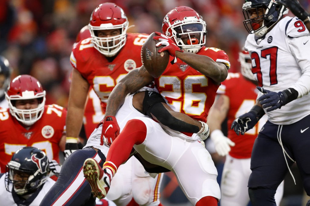 Kansas City Chiefs running back Damien Williams (26) scores a touchdown past Houston Texans safety Justin Reid (20) during the second half of an NFL d...