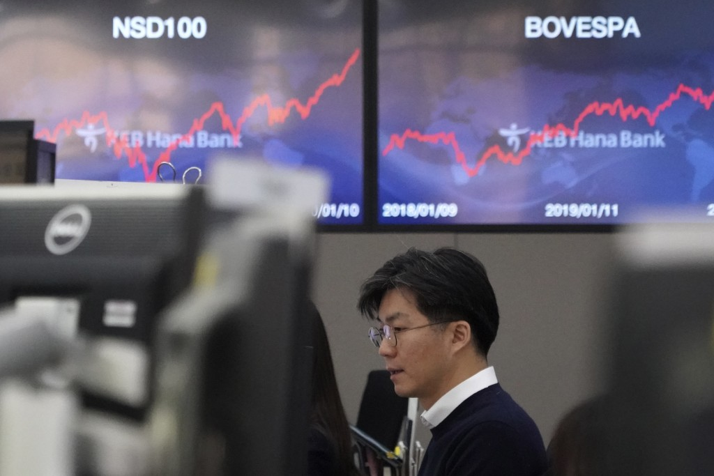 A currency trader watches computer monitors at the foreign exchange dealing room in Seoul, South Korea, Monday, Jan. 13, 2020. Asian stocks have risen...