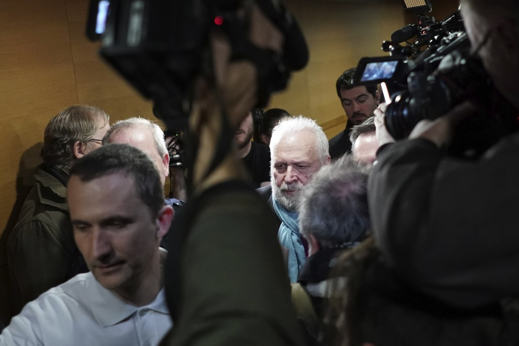 Former French priest Bernard Preynat, center, arrives at the Lyon court house, central France, Monday Jan.13, 2020. Bernard Preynat, is accused of sex...
