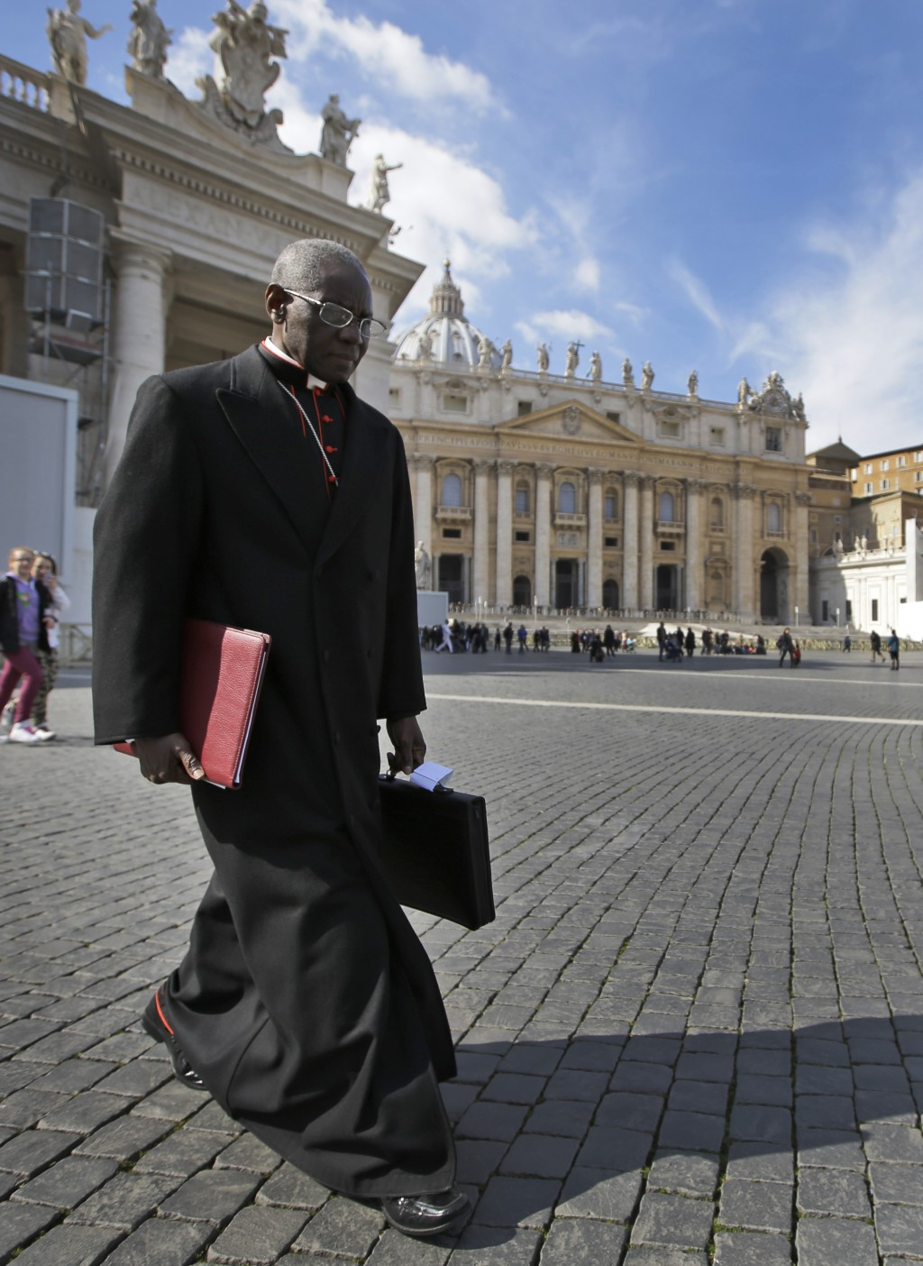 FILE - In this Monday, March 4, 2013 file photo, Cardinal Robert Sarah, of Guinea, walks in St. Peter's Square after attending a cardinals' meeting, a...