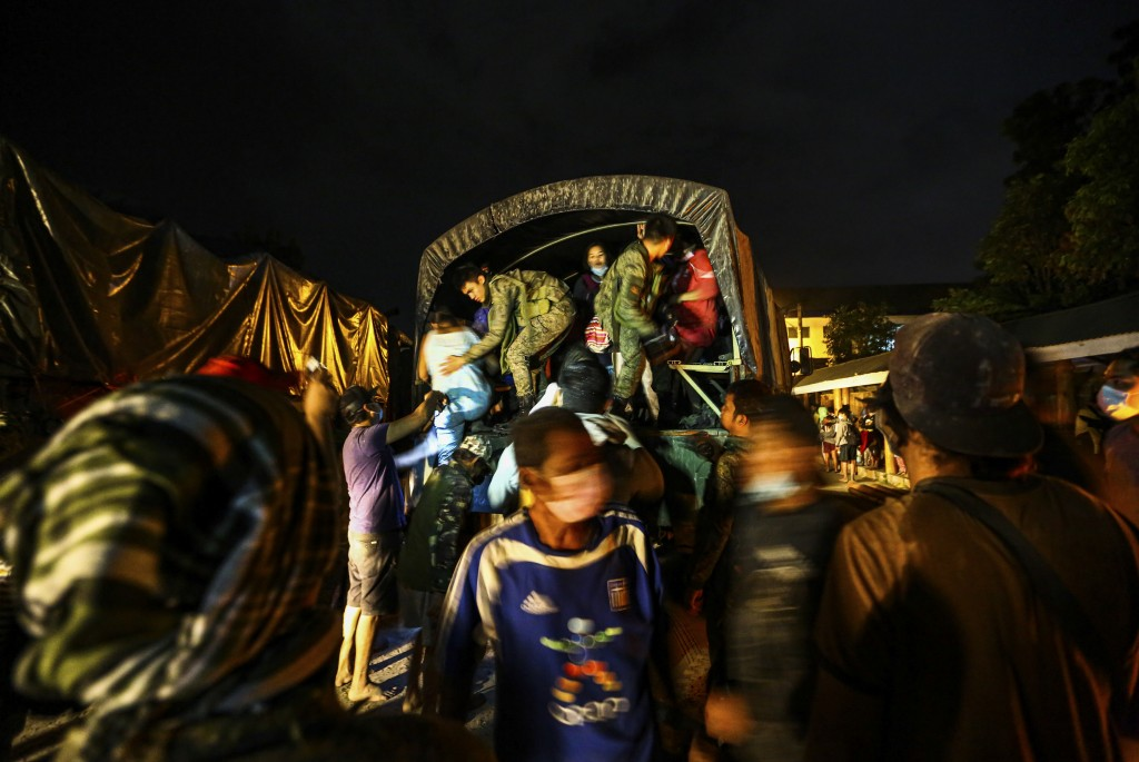 Residents arrive at local school after being evacuated from the heavy ash and debris from the Taal volcano eruption in Santo Tomas, Batangas, southern...