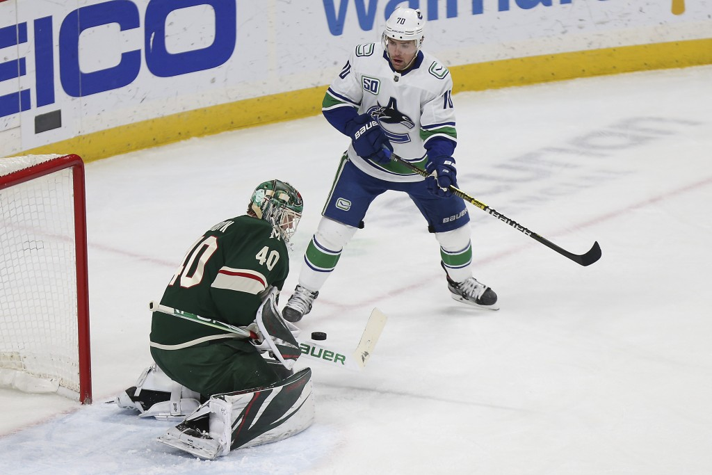 Minnesota Wild's goalie Devan Dubnyk (40) stops the puck in front of the net in the first period of an NHL hockey game against the Vancouver Canucks, ...
