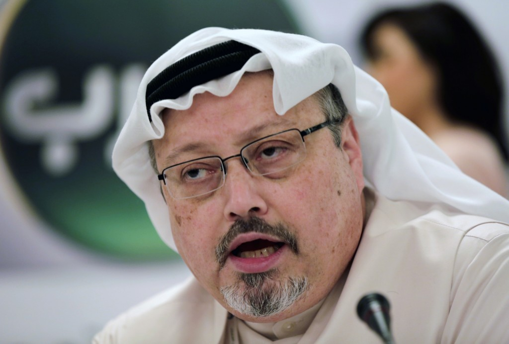 FILE - In this Dec. 15, 2014 file photo, Saudi journalist Jamal Khashoggi speaks during a press conference in Manama, Bahrain. Three leading internati...