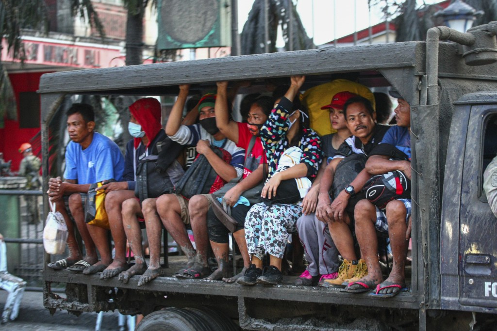 Residents are evacuated as heavy ash and debris from the Taal volcano eruption continues to fall on their town in Talisay, Batangas, southern Philippi...