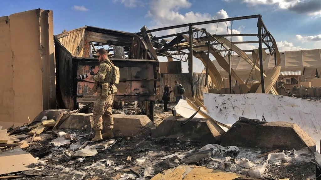U.S. soldiers and journalists inspect the rubble at a site of Iranian bombing, in Ain al-Asad air base, Anbar, Iraq, Monday, Jan. 13, 2020. Ain al-Asa...