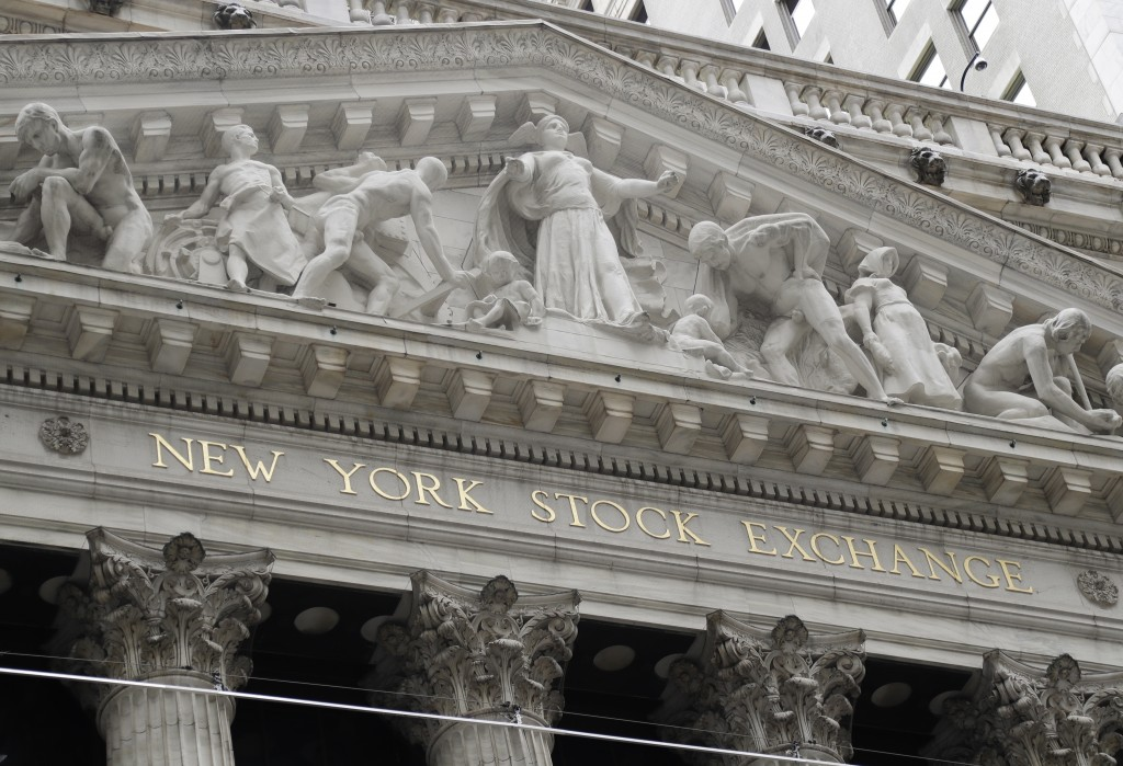 FILE - This Aug. 23, 2019, file photo shows the New York Stock Exchange in New York. Global stock markets are subdued as investors look ahead to the s...
