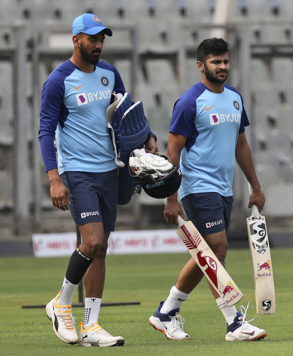 India's K.L.Rahul, left, along with Shardul Thakur attends a training session ahead of their first one-day international cricket match against Austral...