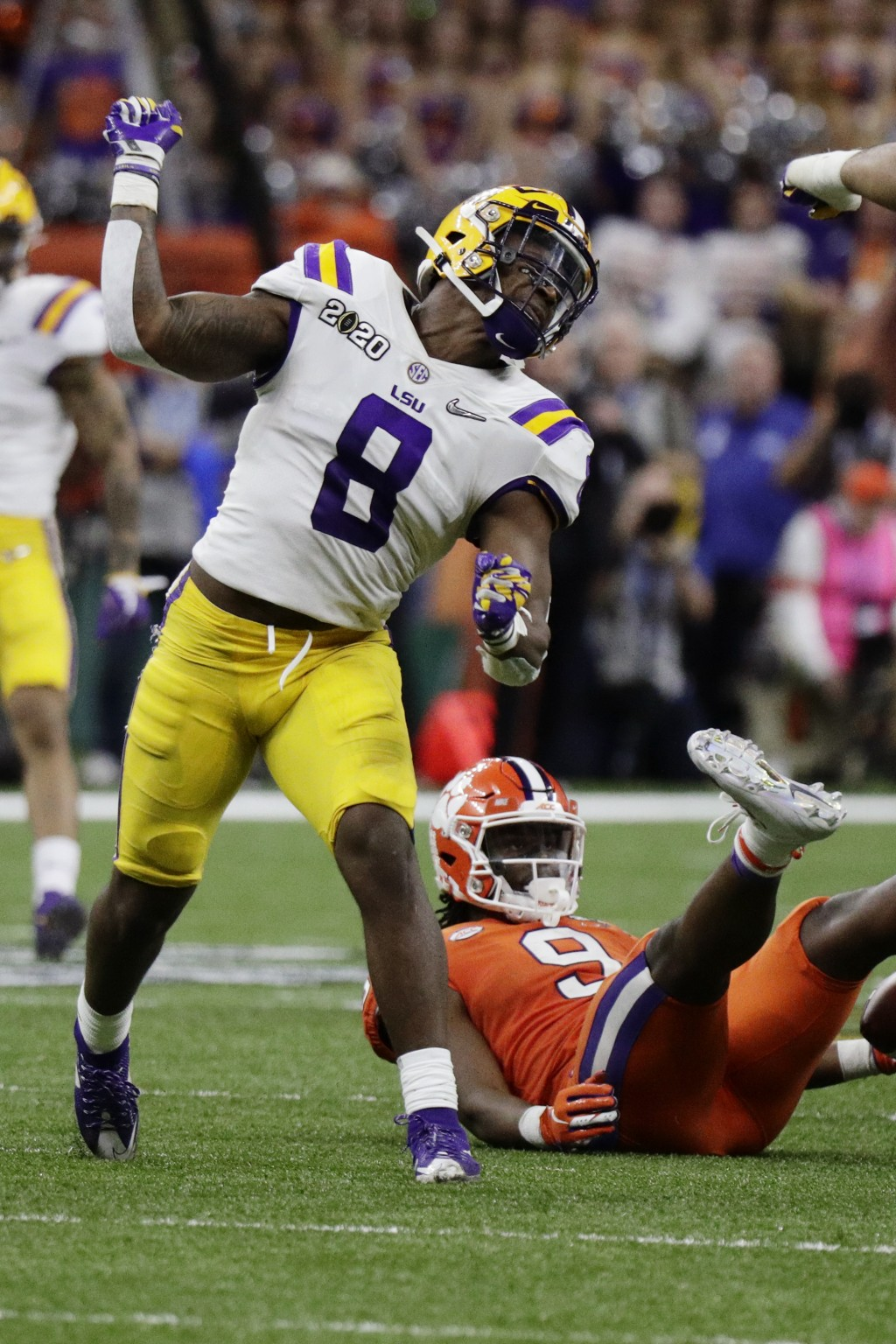 LSU linebacker Patrick Queen celebrates after tackling Clemson running back Travis Etienne during the second half of a NCAA College Football Playoff n...