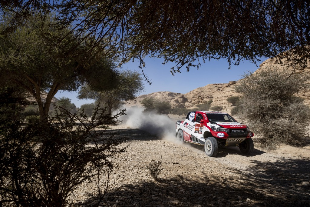 Driver Fernando Alonso, of Spain, and co-driver Marc Coma, of Spain, race their Toyotaduring stage nine of the Dakar Rally between Wadi Al Dawasir and...