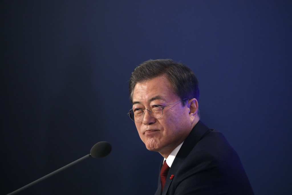 South Korean President Moon Jae-in speaks during his New Year press conference at the presidential Blue House in Seoul, South Korea, Tuesday, Jan. 14,...