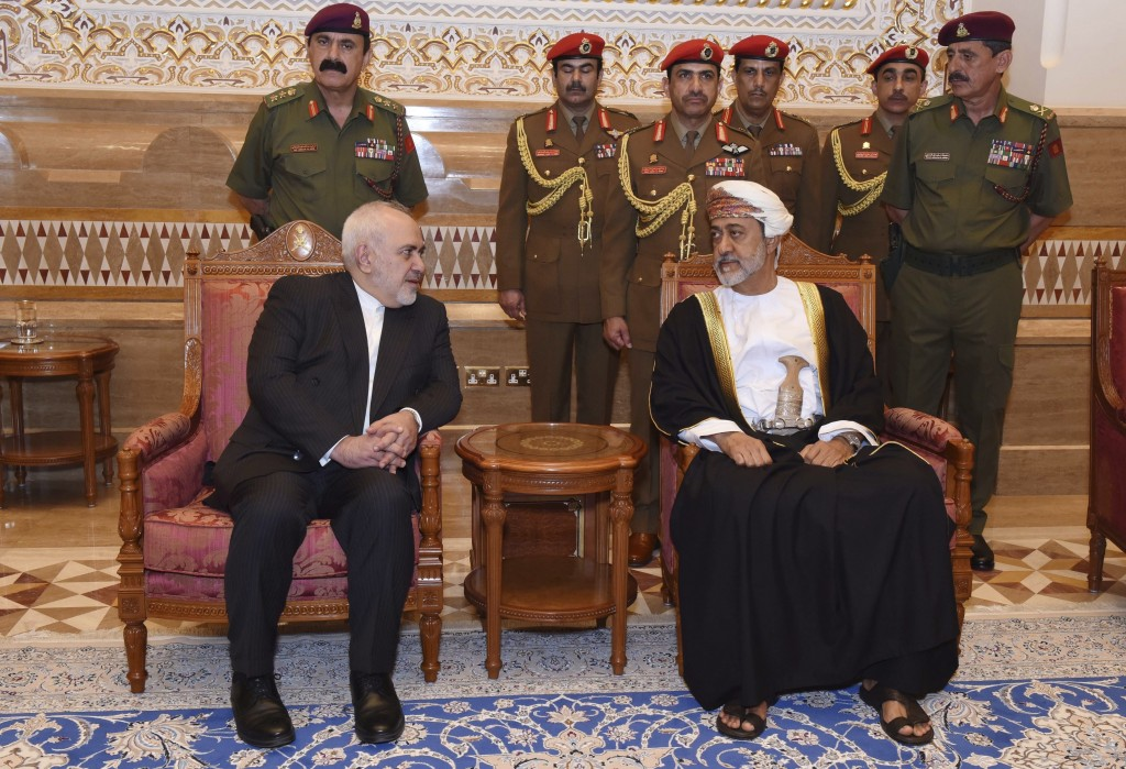 In this Sunday, Jan. 12, 2020 photo, made available by the Oman News Agency, Oman's new Sultan Haitham bin Tariq Al Said, right, receives Iranian Fore...