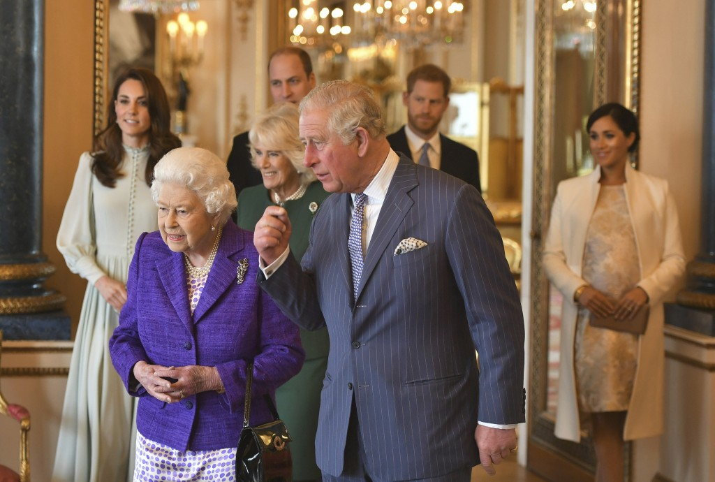 FILE - In this March 5, 2019 file photo, Britain's Queen Elizabeth II is joined by Prince Charles, the Prince of Wales, and at rear, from left, Kate, ...