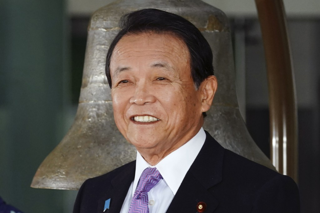 FILE - In this Jan. 6, 2020, file photo, Japan's Finance Minister Taro Aso poses during a ceremony marking the start of this year's trading in Tokyo. ...