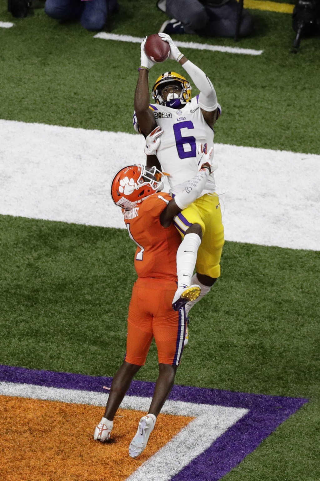 LSU wide receiver Terrace Marshall Jr. catches a touchdown pass over Clemson cornerback Derion Kendrick during the second half of a NCAA College Footb...