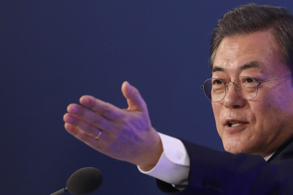 South Korean President Moon Jae-in gestures during his New Year press conference at the presidential Blue House in Seoul, South Korea, Tuesday, Jan. 1...