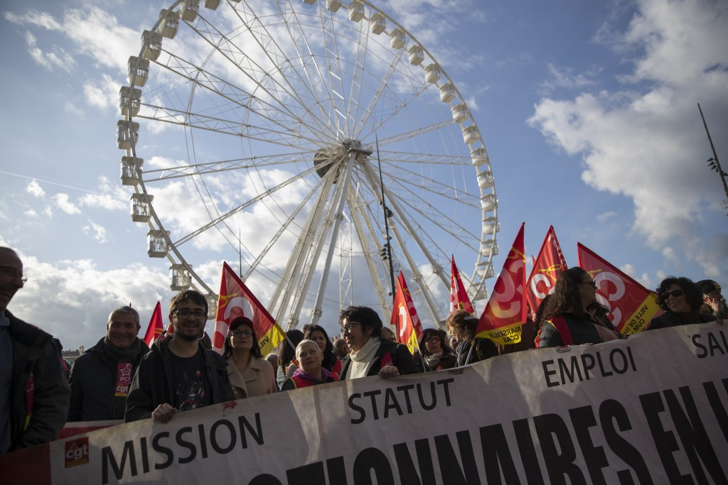 Strikers gather in Marseille's old port during a demonstration Tuesday, Jan. 14, 2020, in Marseille, southern France. Rail workers, teachers, doctors,...