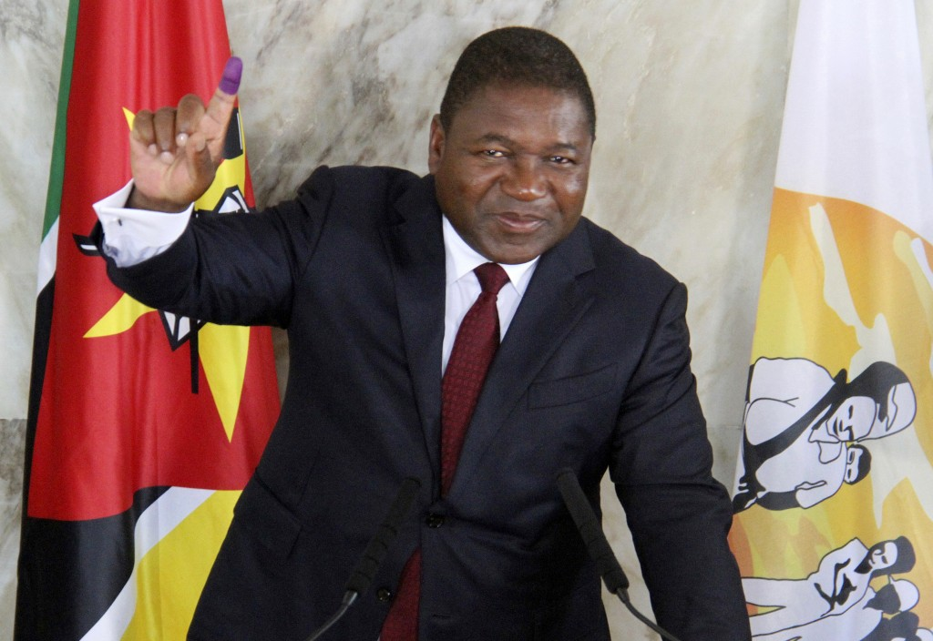 FILE - In this Tuesday, Oct. 15, 2019 file photo, Mozambican President Felipe Nyusi poses at a polling station where he cast his vote in Maputo. Nyusi...